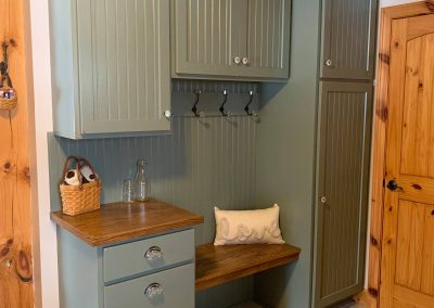 Entryway cabinets with coat hooks and convenient seating